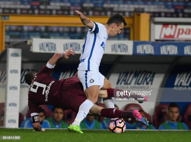 Ivan Perisic of FC Internazionale and Andrea Belotti of FC Torino compete for the ball during the Serie A match between FC Torino and FC...