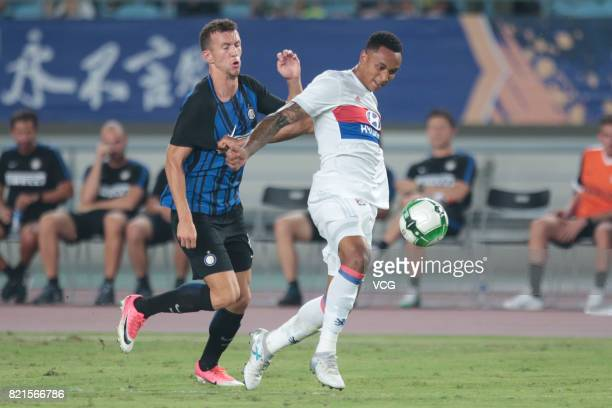 Ivan Perisic of FC Internazionale and Kenny Tete of Lyon compete for the ball during the 2017 International Champions Cup match between FC...