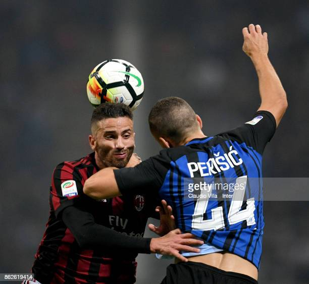 Ivan Perisic of FC Internazionale and Mateo Pablo Musacchio of AC Milan compete for the ball during the Serie A match between FC Internazionale and...