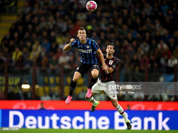 Ivan Perisic of FC Internazionale and Mattia De Sciglio of AC Milan compete for the ball during the Serie A match between FC Internazionale Milano...