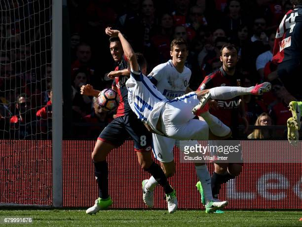 Ivan Perisic of FC Internazionale and Nicolas Burdisso of Genoa CFC compete for the ball during the Serie A match between Genoa CFC and FC...