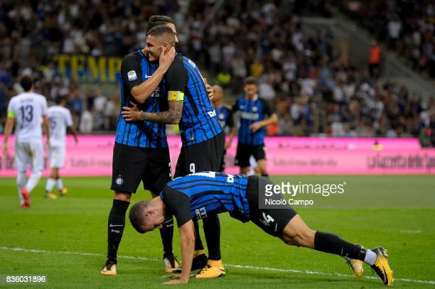 Ivan Perisic of FC Internazionale celebrates after scoring a goal with Danilo D'Ambrosio and Mauro Icardi during the Serie A football match between...