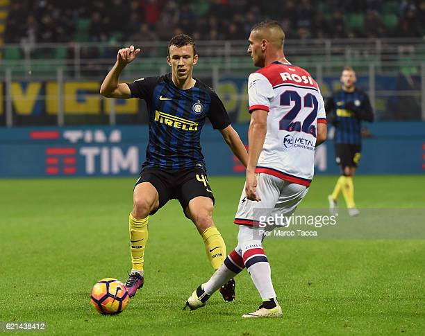 Ivan Perisic of FC Internazionale competes for the ball with Aleandro Rosi of FC Crotone during the Serie A match between FC Internazionale and FC...
