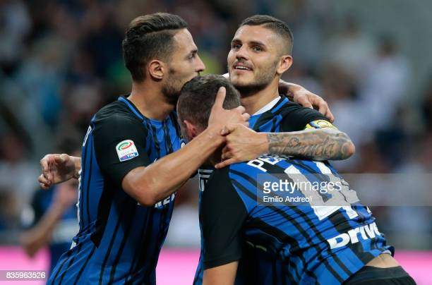 Ivan Perisic of FC Internazionale Milano celebrates his goal with his teammates Mauro Emanuel Icardi and Danilo D Ambrosio during the Serie A match...