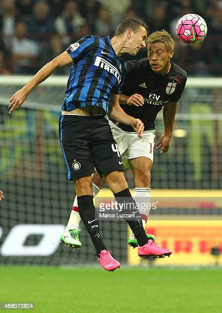 Ivan Perisic of FC Internazionale Milano competes for the ball with Keisuke Honda of AC Milan during the Serie A match between FC Internazionale...