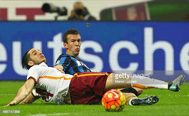 Ivan Perisic of FC Internazionale Milano competes for the ball with Konstantinos Manolas of AS Roma during the Serie A match between FC...