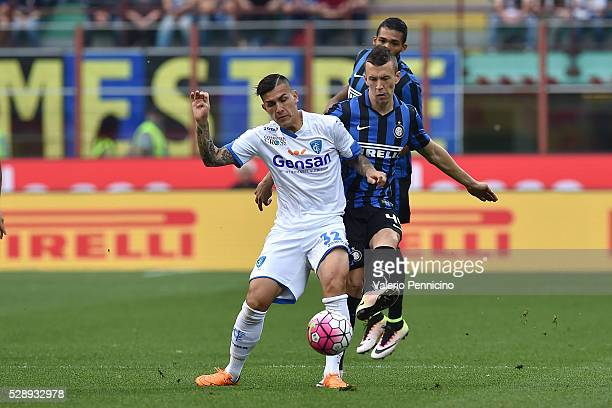 Ivan Perisic of FC Internazionale Milano competes with Leandro Paredes of Empoli FC during the Serie A match between FC Internazionale Milano and...