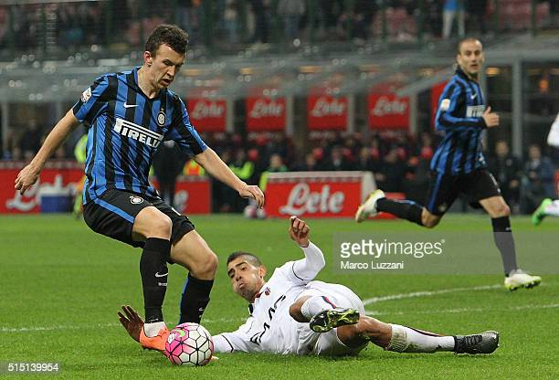 Ivan Perisic of FC Internazionale Milano is challenged by Adam Masina of Bologna FC during the Serie A match between FC Internazionale Milano and...