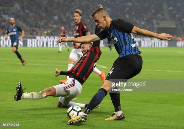Ivan Perisic of FC Internazionale Milano is challenged by Mateo Pablo Musacchio of AC Milan during the Serie A match between FC Internazionale and AC...