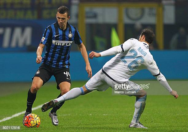 Ivan Perisic of FC Internazionale Milano is challenged by Stefan Radu of SS Lazio during the Serie A match between FC Internazionale Milano and SS...