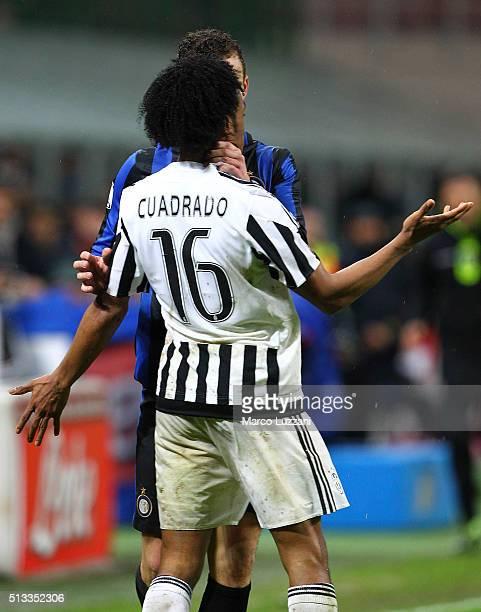 Ivan Perisic of FC Internazionale Milano pushes Juan Cuadrado of Juventus FC during the TIM Cup match between FC Internazionale Milano and Juventus...