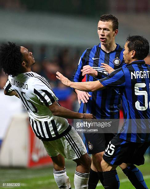 Ivan Perisic of FC Internazionale Milano pushes Juan Cuadrado of Juventus FC during the TIM Cup match between FC Internazionale Milano and Juventus...