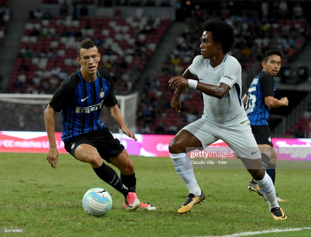 Ivan Perisic of FC Internazionale of FC Internazionale and Willian of Chelsea FC compete for the ball during the International Champions Cup match between Chelsea FC and FC Internazionale at National Stadium on July 29, 2017 in Singapore.
