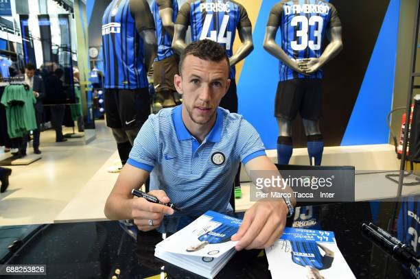 Ivan Perisic of FC Internazionale signs FC Internazionale merchandise in store as the FC Internazionale new 2017/18 kit is unveiled at Club Store on...