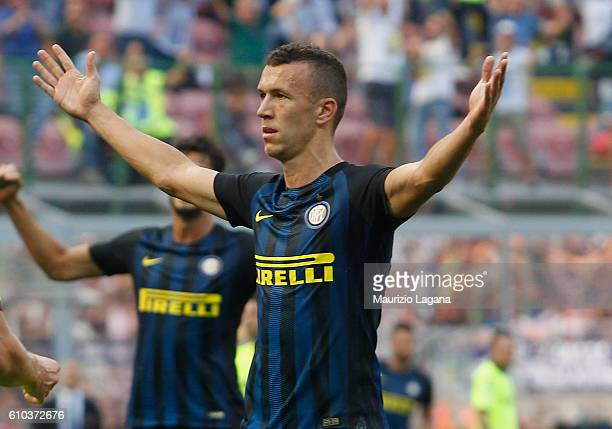 Ivan Perisic of Inter celebrates after scoring his team's opening goal during the Serie A match between FC Internazionale and Bologna FC at Stadio...