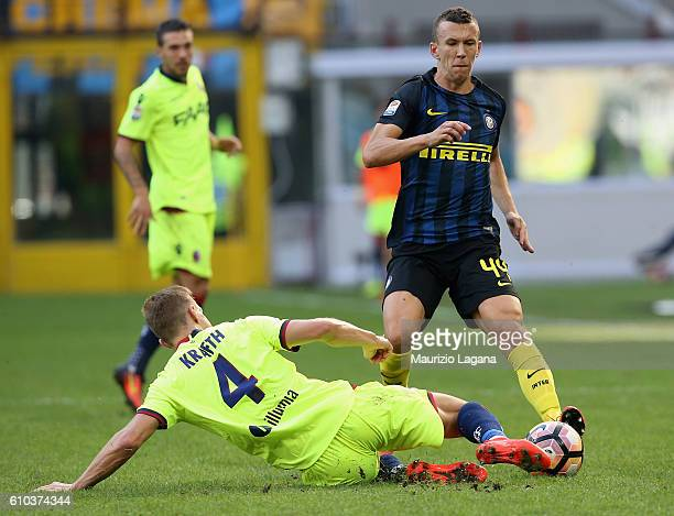 Ivan Perisic of Inter competes for the ball with Emil Krafth of Bologna during the Serie A match between FC Internazionale and Bologna FC at Stadio...