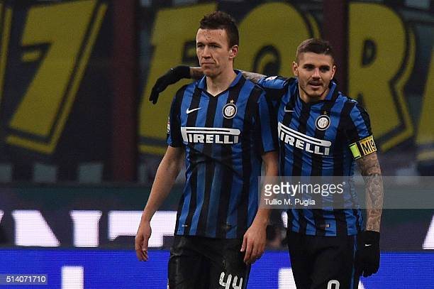 Ivan Perisic of Inter is celebrated by his team mate Mauro Icardi after scoring his team's third goal during the Serie A match between FC...