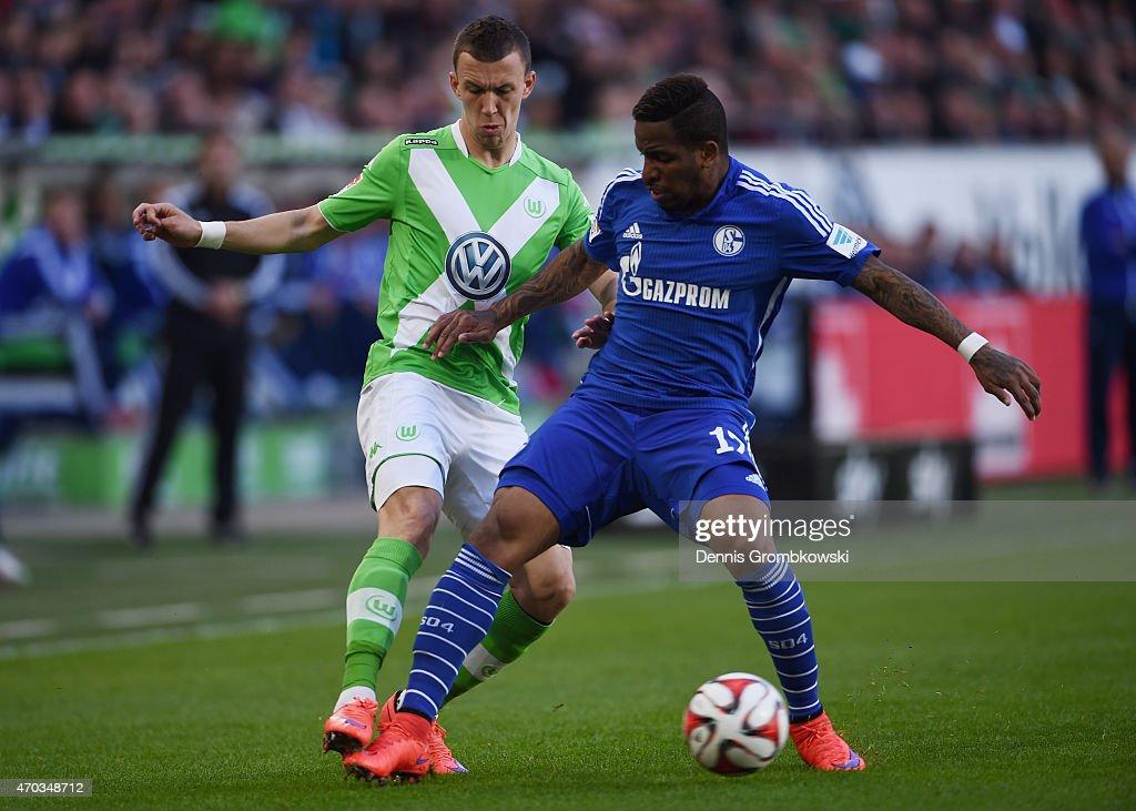 Ivan Perisic of VfL Wolfsburg and Jefferson Farfan of FC Schalke 04 battle for the ball during the Bundesliga match between VfL Wolfsburg and FC...
