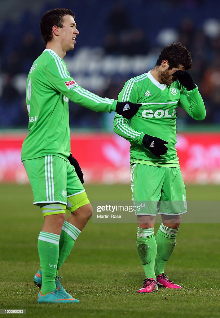 Ivan Perisic (L) of Wolfsburg and team mate Vieirinha (R) look dejected during the Bundesliga match between Hannover 96 and VfL Wolfsburg at AWD Arena on January 26, 2013 in Hannover, Germany.
