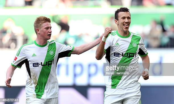 Ivan Perisic of Wolfsburg celebrates after scoring his team's second goal with Kevin de Bruyne of Wolfsburg during the Bundesliga match between VfL...