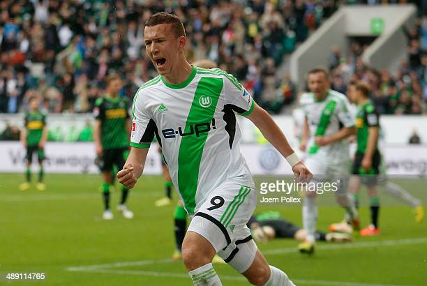 Ivan Perisic of Wolfsburg celebrates after scoring his team's second goal during the Bundesliga match between at Volkswagen Arena on May 10 2014 in...
