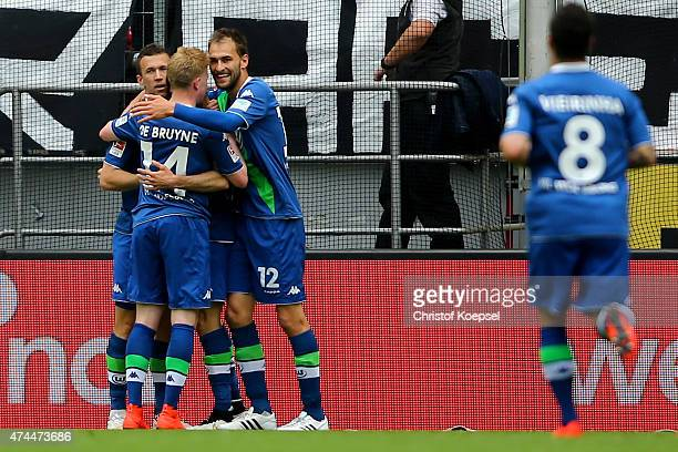 Ivan Perisic of Wolfsburg celebrates the second goal with Kevin de Bruyne and Bas Dost of Wolfsburg during the Bundesliga match between 1 FC Koelan...