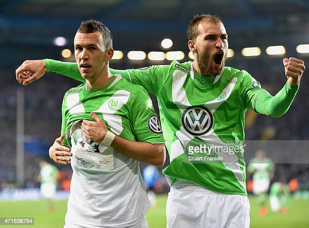 Ivan Perisic of Wolfsburg celebrates with his teammate Bas Dost of Wolfsburg after scoring his team's third goal during the DFB Cup Semi Final match...
