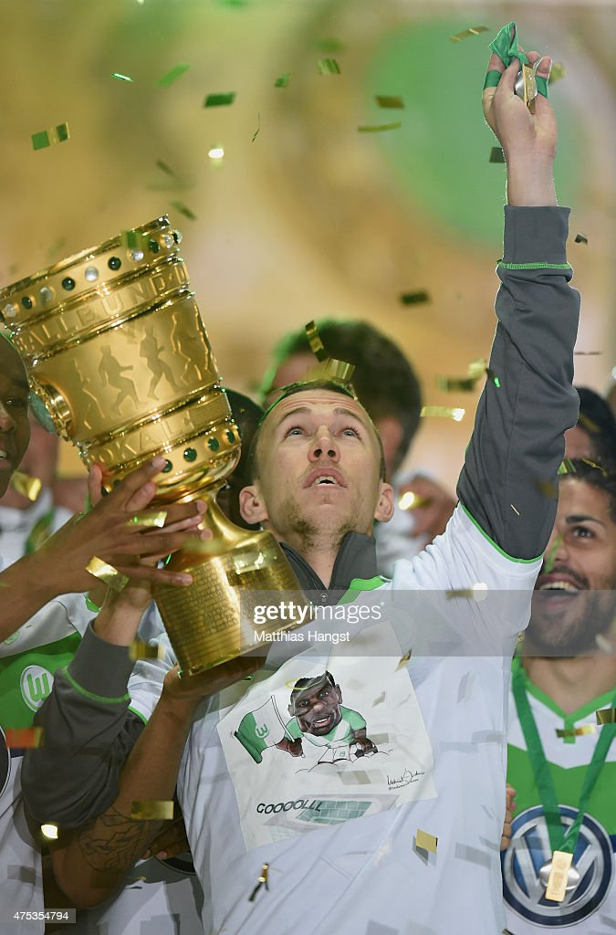 Ivan Perisic of Wolfsburg of VfL Wolfsburg celebrates with the trophy and a speacial shirt after his teams victory in during the DFB Cup Final match between Borussia Dortmund and VfL Wolfsburg at Olympiastadion on May 30, 2015 in Berlin, Germany.