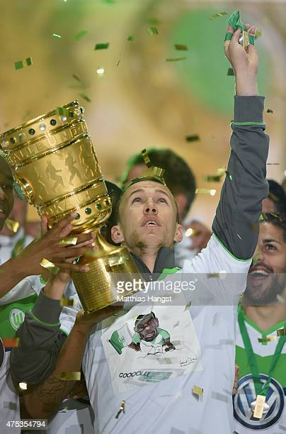 Ivan Perisic of Wolfsburg of VfL Wolfsburg celebrates with the trophy and a speacial shirt after his teams victory in during the DFB Cup Final match...