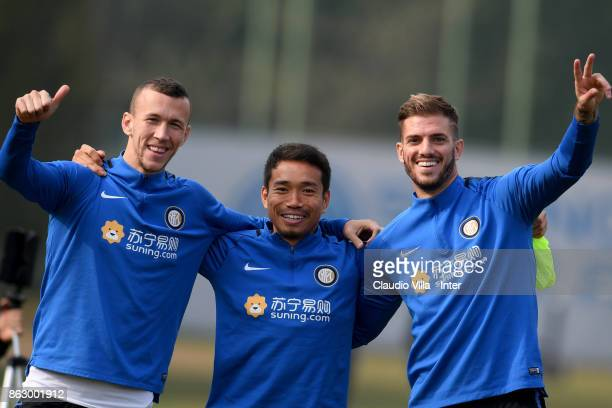 Ivan Perisic Yuto Nagatomo and Davide Santon of FC Internazionale pose for a photo prior to the training session at Suning Training Center at Appiano...