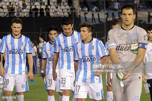 Ivan Pillud Nelson Acevedo Yonathan Cabral Gaston Diaz and Marcos Acuña of Racing Club leave the field with their teammates after losing during a...