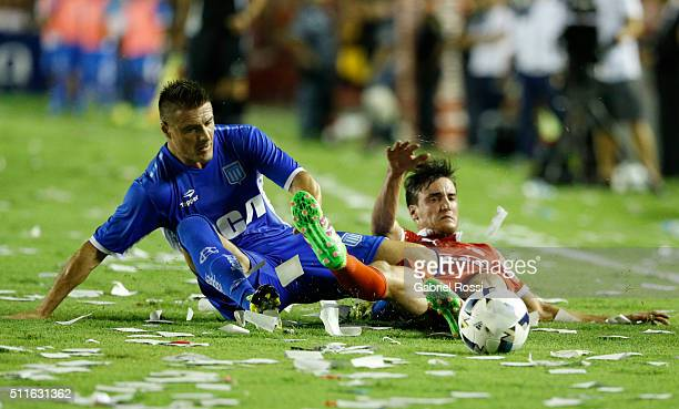 Ivan Pillud of Racing Club fights for the ball with Nicolas Tagliafico of Independiente during the 4th round match between Independiente and Racing...