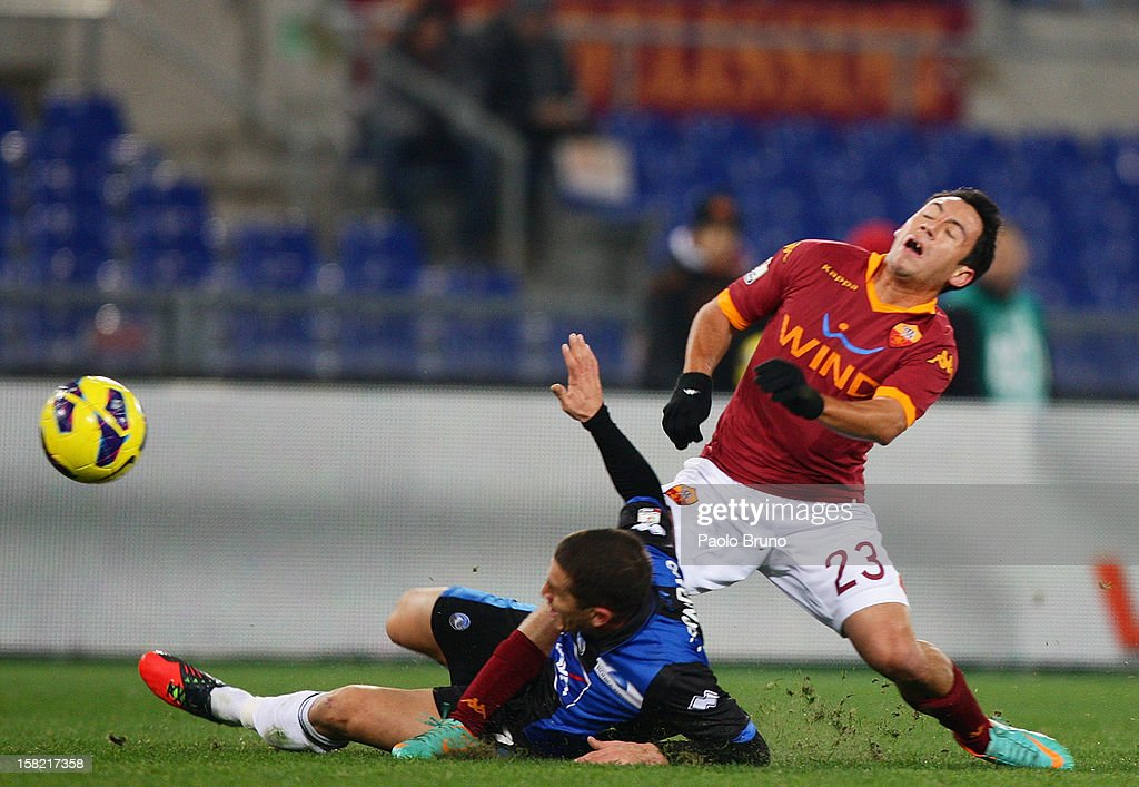 Ivan Piris(R) of AS Roma competes for the ball with <a gi-track='captionPersonalityLinkClicked' href=/galleries/search?phrase=Carlos+Carmona&family=editorial&specificpeople=3035631 ng-click='$event.stopPropagation()'>Carlos Carmona</a> of Atalanta BC during the TIM Cup match between AS Roma and Atalanta BC at Olimpico Stadium on December 11, 2012 in Rome, Italy.