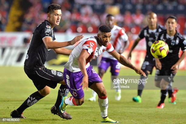 Ivan Piris of Monterrey and Freddy Hinestroza of Puebla fight for the ball during the 16th round match between Veracruz and Monterrey as part of the...