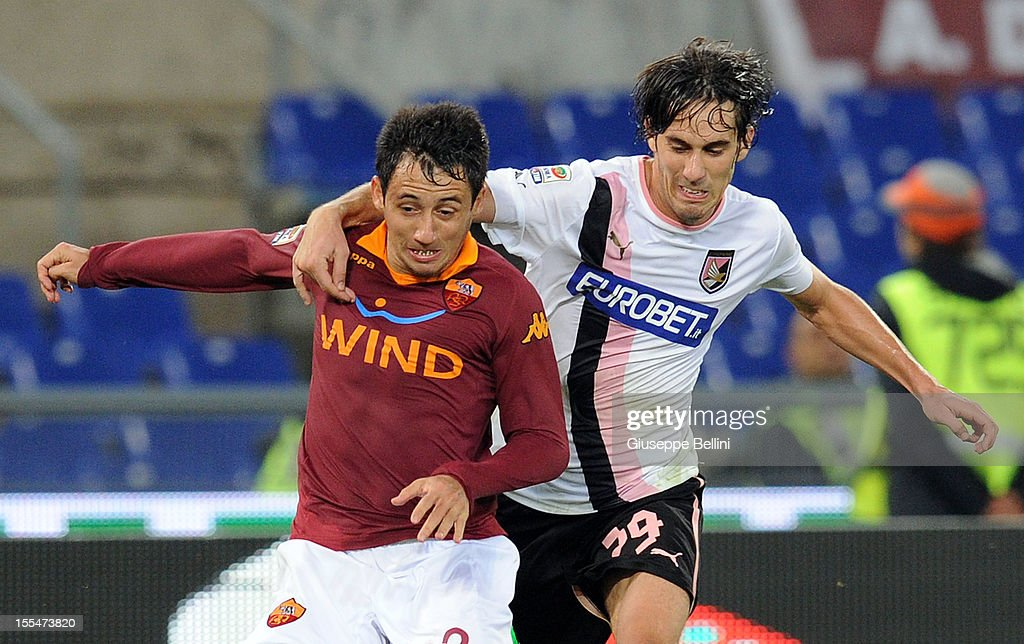 <a gi-track='captionPersonalityLinkClicked' href=/galleries/search?phrase=Ivan+Piris&family=editorial&specificpeople=5348316 ng-click='$event.stopPropagation()'>Ivan Piris</a> of Roma and Santiago Garcia of Palermo in action during the Serie A match between AS Roma and US Citta di Palermo at Stadio Olimpico on November 4, 2012 in Rome, Italy.
