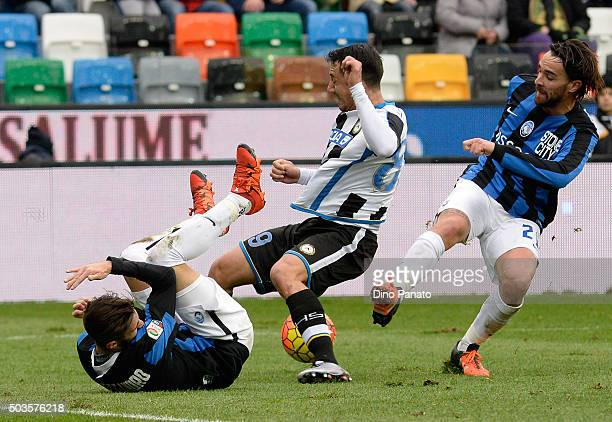 Ivan Piris of Udinese Calcio competes with Marco Dalessandro and Luca Cigarini of Atalanta BC during the Serie A match between Udinese Calcio v...