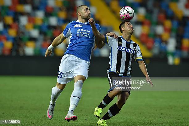 Ivan Piris of Udinese Calcio is challenged by Andrey Galabinov of Novara Calcio during the TIM Cup match between Udinese Calcio and Novara Calcio at...