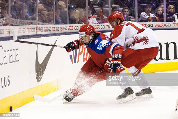 Ivan Provorov of Russia moves the puck against Marcus Nielsen of Denmark during the 2015 IIHF World Junior Championship prelims on December 26 2014...