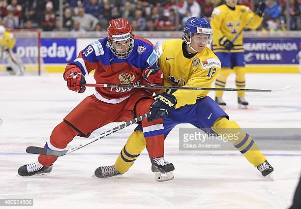 Ivan Provorov of Team Russia battles against Victor Olofsson of Team Sweden in a 2015 IIHF World Junior Hockey Championship game at the Air Canada...