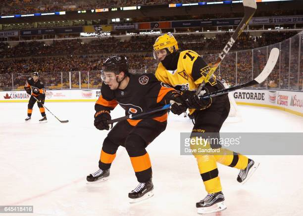 Ivan Provorov of the Philadelphia Flyers and Evgeni Malkin of the Pittsburgh Penguins vie for position during the third period of the 2017 Coors...