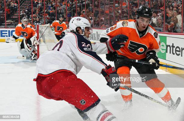 Ivan Provorov of the Philadelphia Flyers battles in the corner against Brandon Saad of the Columbus Blue Jackets on April 8 2017 at the Wells Fargo...