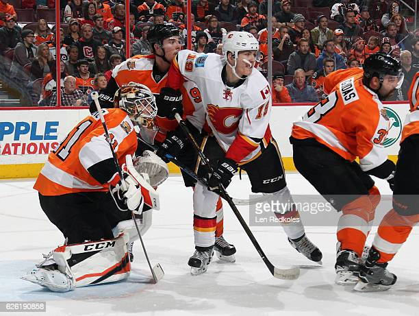 Ivan Provorov of the Philadelphia Flyers defends goaltender Anthony Stolarz against Matthew Tkachuk of the Calgary Flames on November 27 2016 at the...