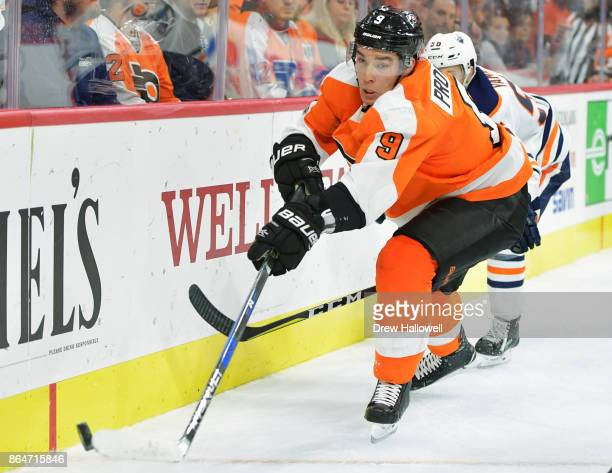Ivan Provorov of the Philadelphia Flyers looks to clear the puck from Kailer Yamamoto of the Edmonton Oilers at the Wells Fargo Center on October 21...