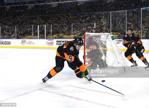 Ivan Provorov of the Philadelphia Flyers reaches for the puck against the Pittsburgh Penguins at Heinz Field on February 25 2017 in Pittsburgh...