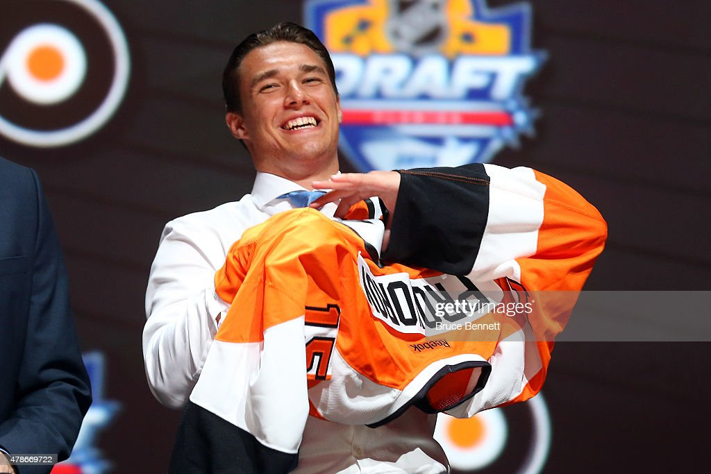 Ivan Provorov puts on his jersey after being selected seventh overall by the Philadelphia Flyers in the first round of the 2015 NHL Draft at BB&T Center on June 26, 2015 in Sunrise, Florida.