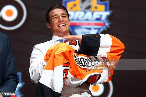Ivan Provorov puts on his jersey after being selected seventh overall by the Philadelphia Flyers in the first round of the 2015 NHL Draft at BBT...
