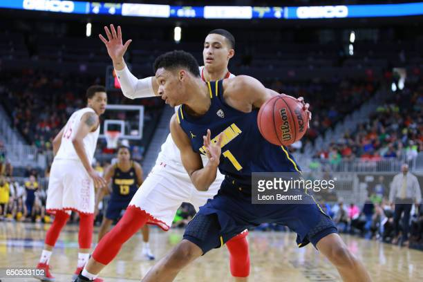 Ivan Rabb of California Golden Bears handles the ball against Kyle Kuzma of the Utah Utes during a quarterfinal game of the Pac12 Basketball...