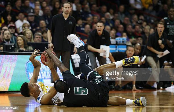 Ivan Rabb of the California Golden Bears and Roderick Bobbitt of the Hawaii Warriors go after a loose ball in the first half during the first round...