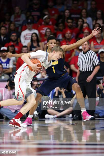 Ivan Rabb of the California Golden Bears defends Lauri Markkanen of the Arizona Wildcats during the first half of the college basketball game at...
