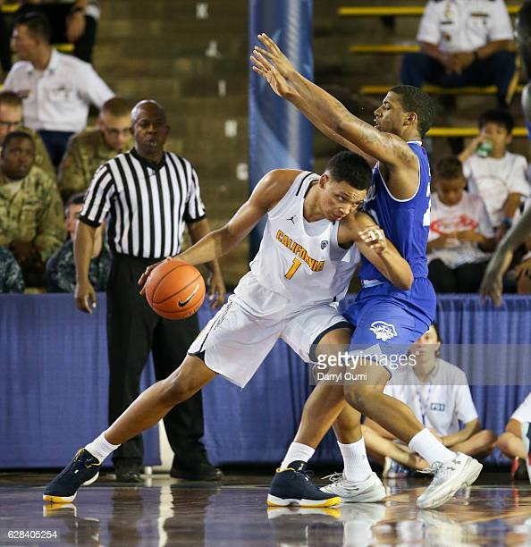 Ivan Rabb of the California Golden Bears draws a foul from Desi Rodriguez of the Seton Hall Piratesa during the second half of the Pearl Harbor...